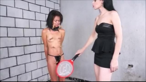 A hot blonde dominatrix punishing the subject