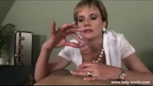 Lady Sonia is a cock loving secretary who likes to get properly clothed every day